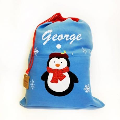Glitter Text Blue Santa Sack Penguin