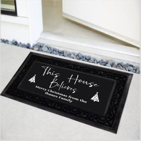Personalised Christmas Doormat This house believes
